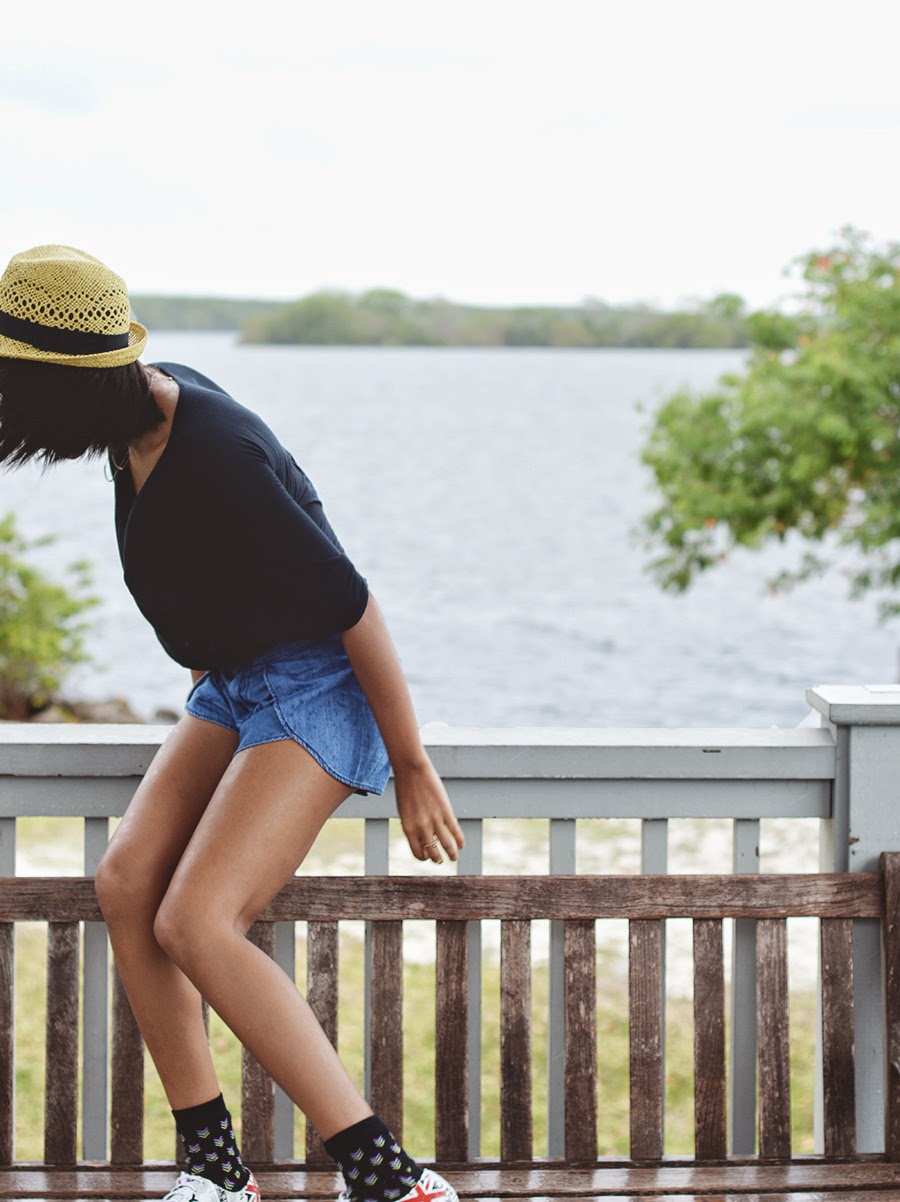 Indie fashion blogger Anais Alexandre in a low key grunge outfit during a summer shower at biscayne national park
