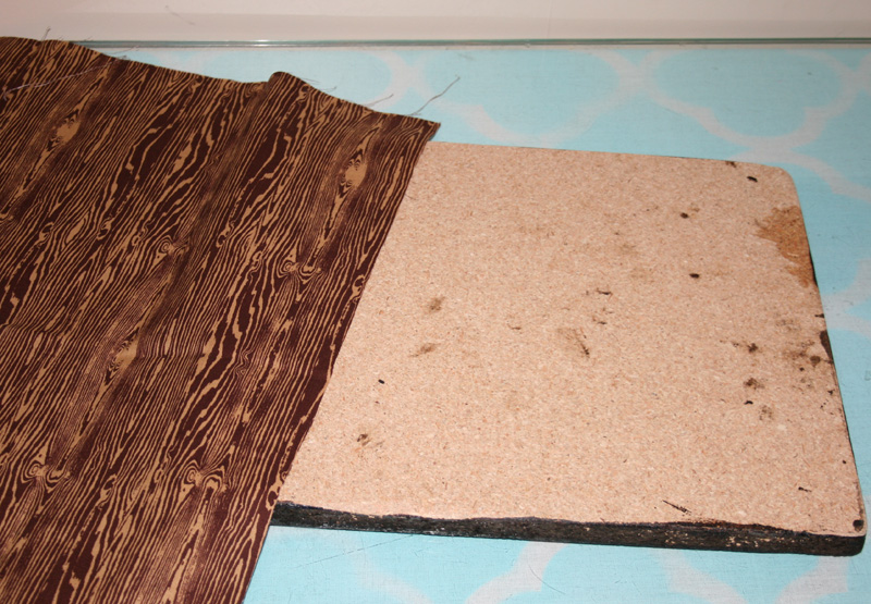 cut a piece of wood grain fabric to the size of your wood panel