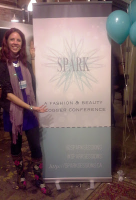 melanie from the purple scarf at spark sessions, Canada's first and only fashion and beauty blogging conference sign