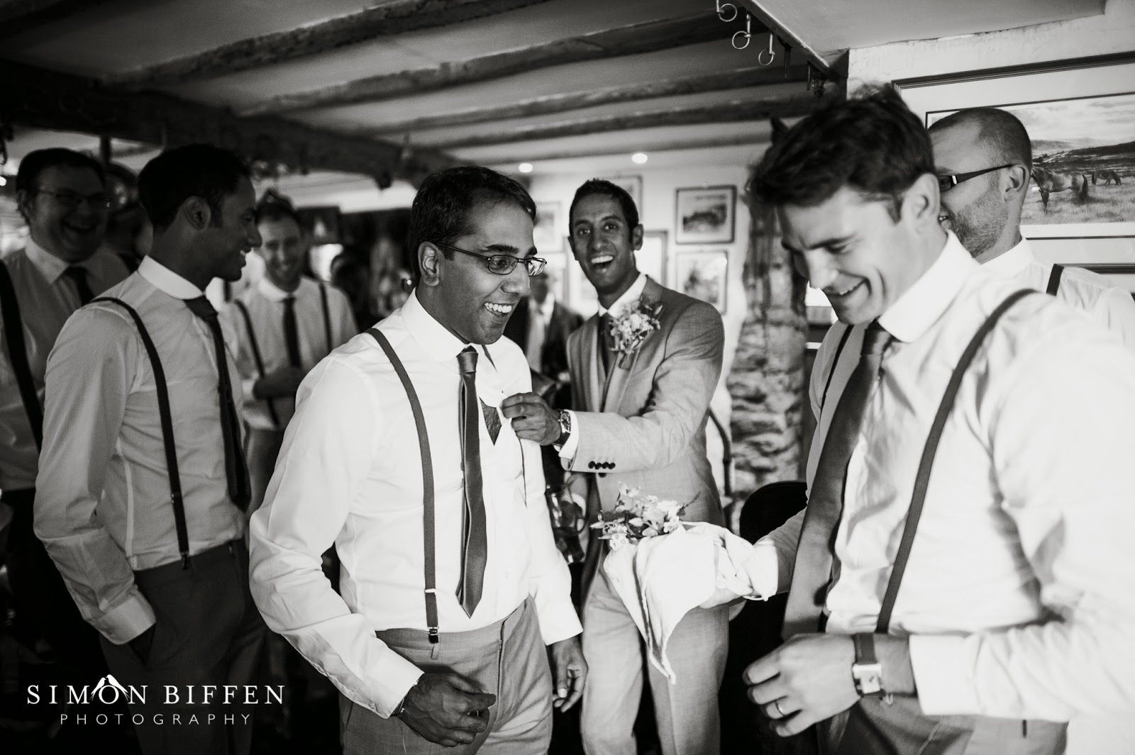 groom and ushers getting ready in the pub