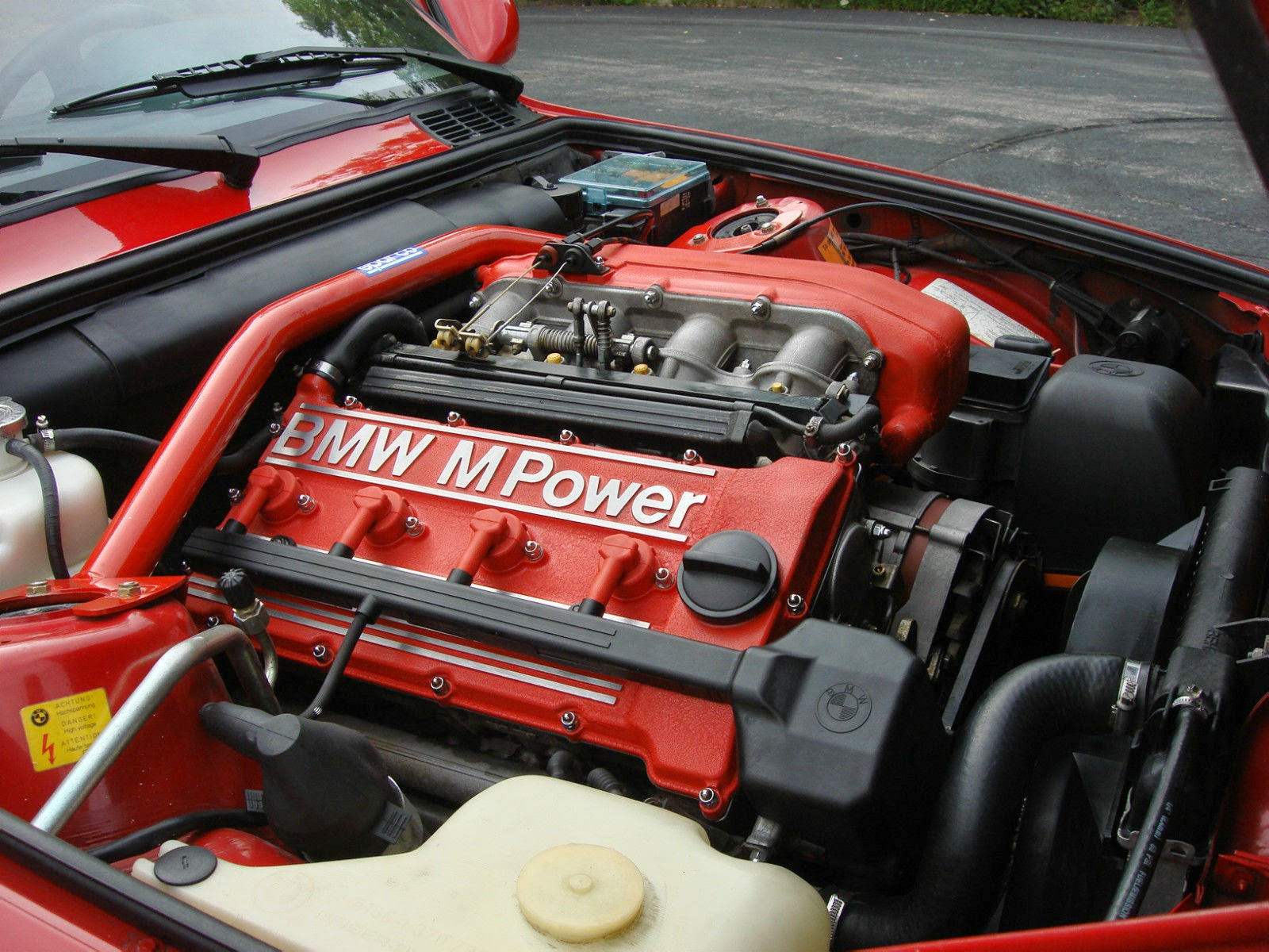 Making a racket under the hood of an e30 m3 is an engine surprisingly short on cylinders a dohc inline 4 the s14b23 that puts out 192 horsepower and 200