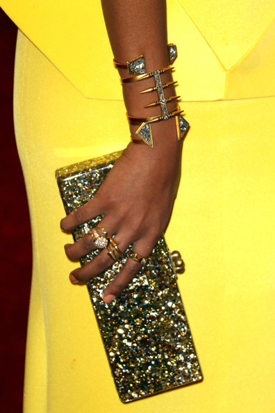 Solange Knowles paired her bright, bold yellow Rachel Roy peplum gown with a gold emboridered Edie Parker clutch, stacked gold rings, a tribal cuff bracelet and Sergio Rossi heels at the Costume Institute Benefit Gala 2012 held at The Metropolitan Museum of Art on May 7, 2012 in New York City.