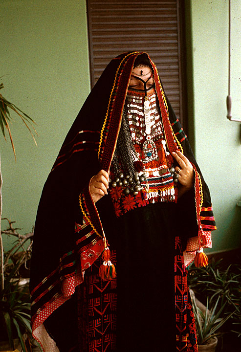 Popular Bahia Cut Her Hair Short And Began Wearing The Jalabiya, A Long Robe Worn By Men