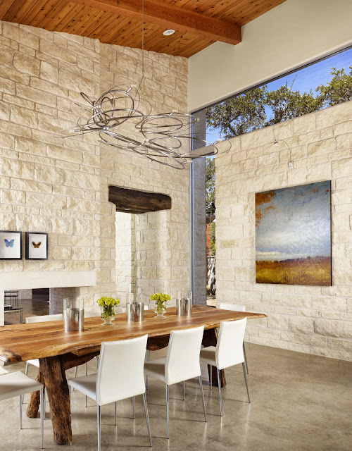 an open plan space conveyed with landscape wall art and glass wall