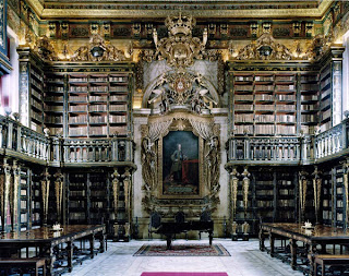 A beautiful old library on two levels in dark wood found in Portugal