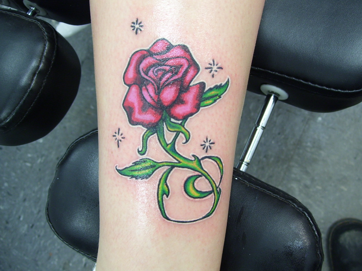 Rose tattoo on thigh 1973