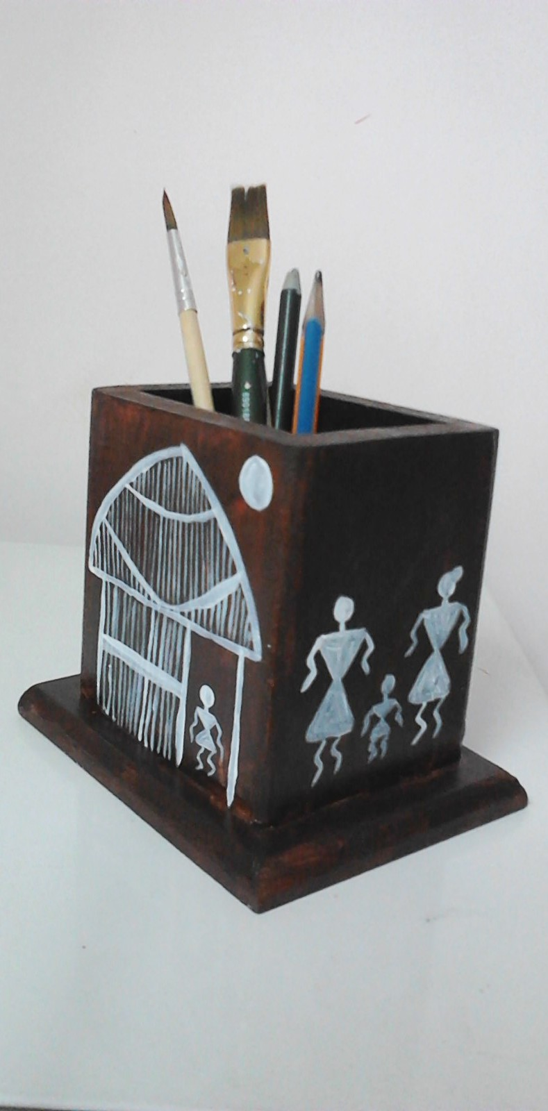 Farah art creations wooden penstand warli painting for Creation stand