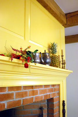 Colonial yellow fireplace surround