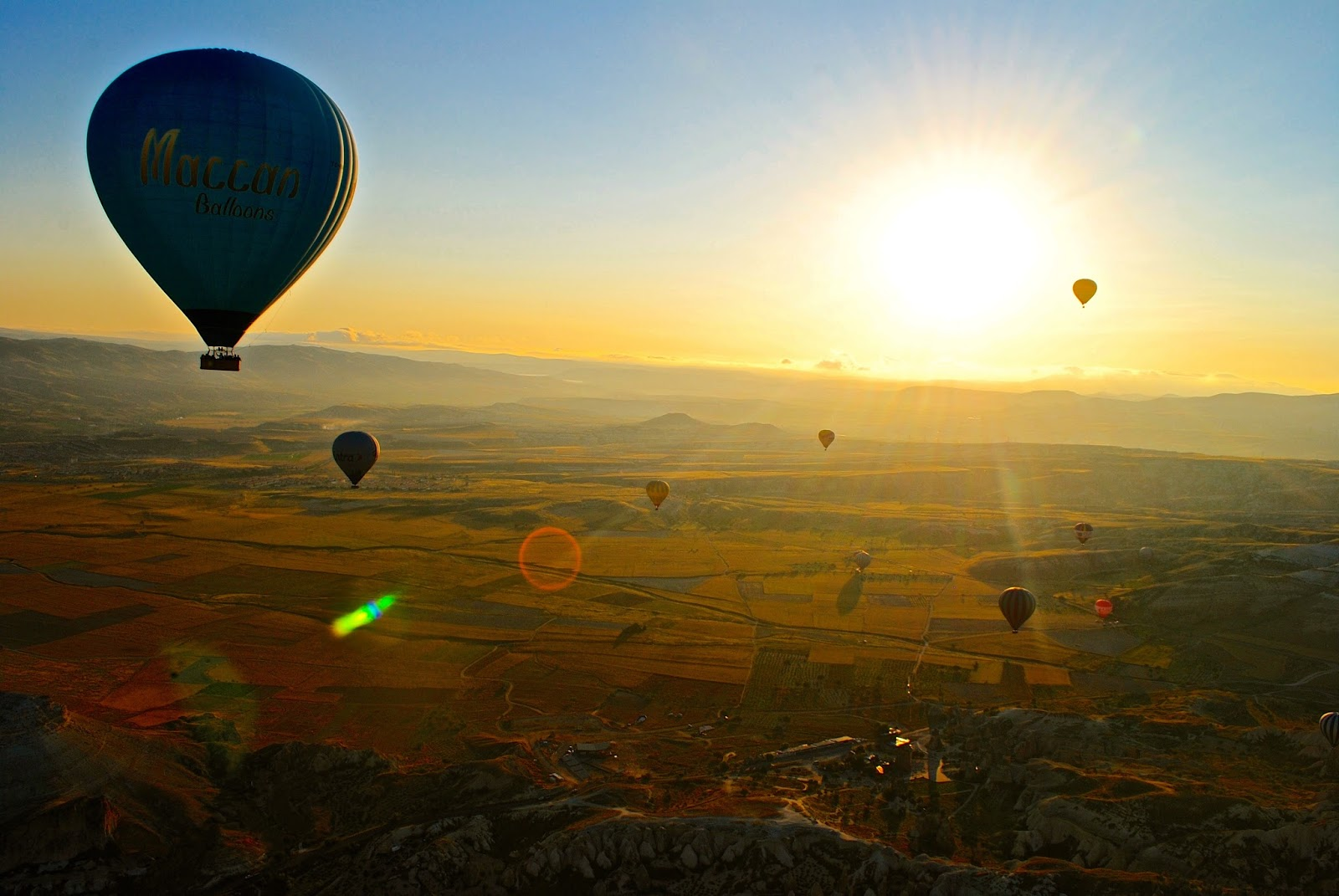 Hot Air Ballooning over Cappadocia at Sunrise with Butterfly Balloons