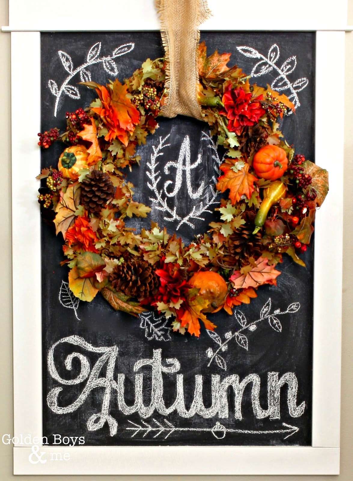 Fall wreath displayed on chalkboard with autumn chalk art-www.goldenboysandme.com