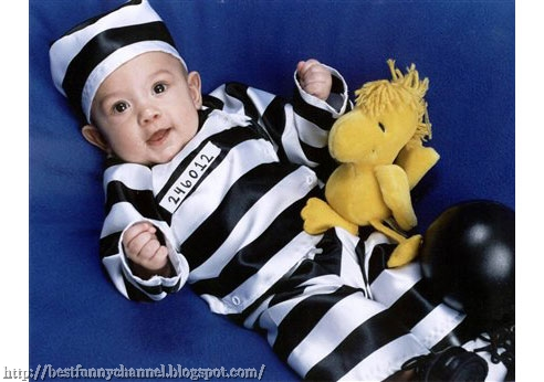 Funny baby in costume a prisoner.