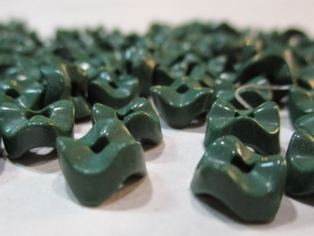 https://www.etsy.com/listing/218478991/107-dark-green-glass-vertebrae-beads?ref=shop_home_active_10