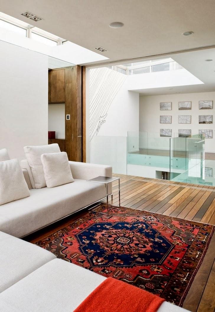 White sofa in Modern dream home by Paz Arquitectura
