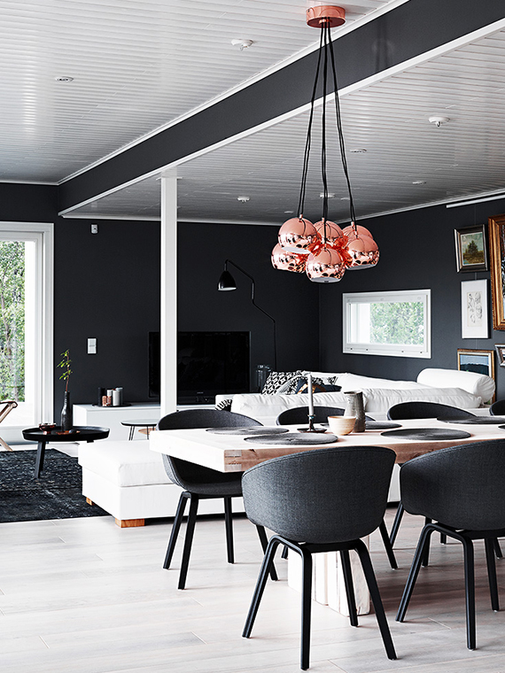Eclectic finnish home with black walls. Photo by Krista Keltanen