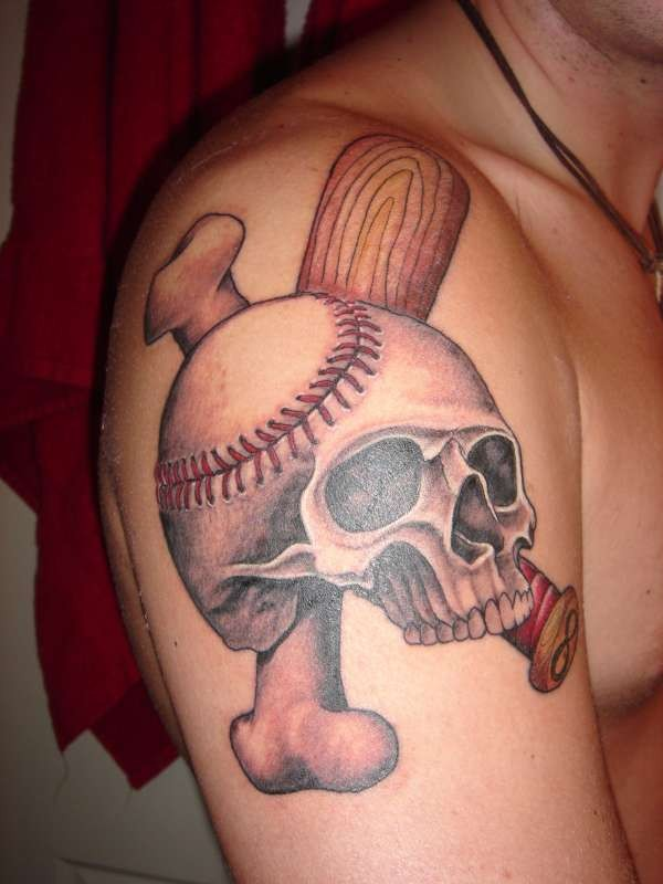 Interesting skull in the style of baseball tattoo on shoulder
