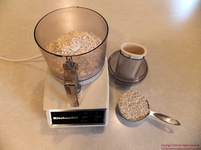 Into a food processor or blender measure 2 cups gluten-free oats.