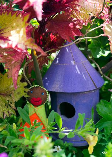 Little Mother beside a little house in a big garden!