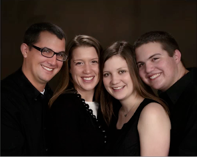 Photo of four siblings to be used as example by Photoshop teacher