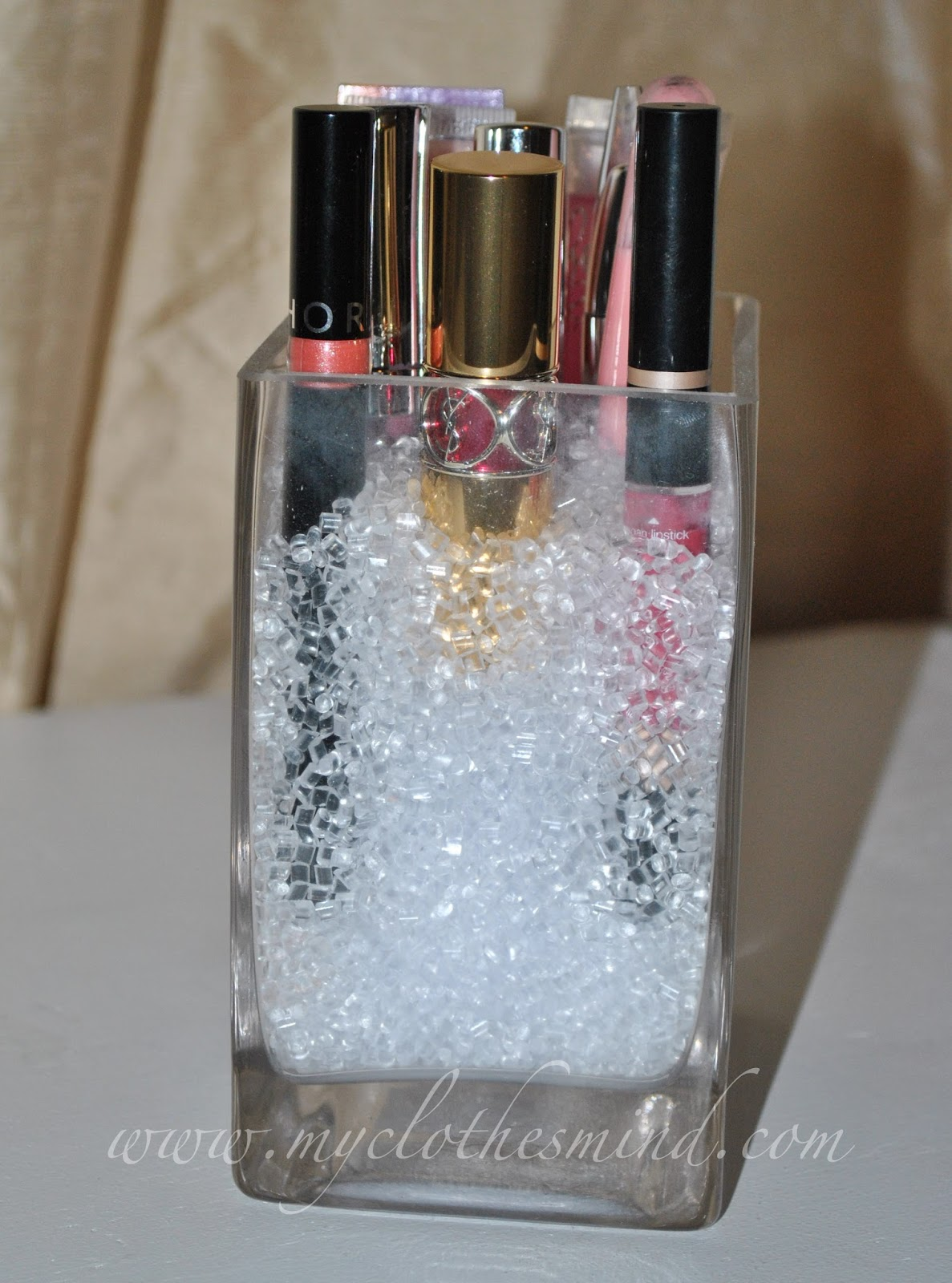 makeup brush holder beads. try a glass jar from the dollar tree and add clear beads michael\u0027s to store makeup. makeup brush holder