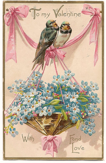 Two love birds with a hanging basket of forget-me-nots