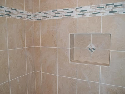 "Frameless tile niche uses matching accent ""diamond"" inset"