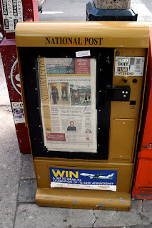 National Post newspaper box in gold.