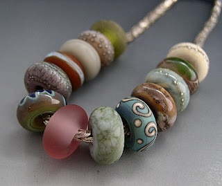 Handmade glass beads by Naos Glass