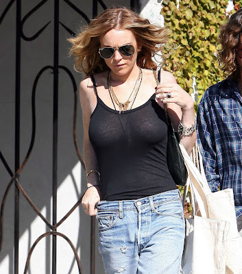 Lindsay Lohan Is Braless And In See-Through Shirt
