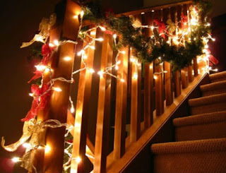 Christmas decorations stairs is entangled decorative wreaths through the bars of the railing