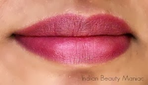 Oriflame More by Demi Lipstick in Pink Drama swatch stain on lips