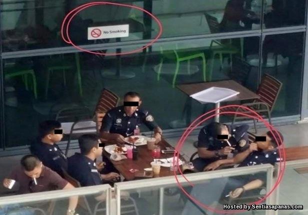 Polis Bantuan Merokok Di Zon Larangan