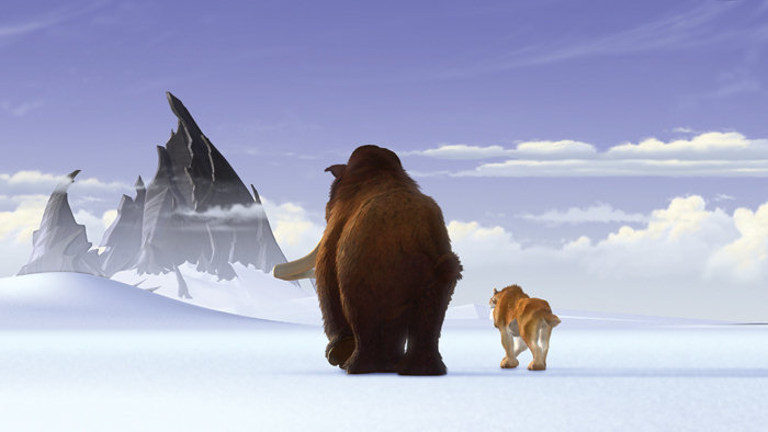 Manny and Diego walking toward some mountains in Ice Age 2002 disneyjuniorblog.blogspot.com