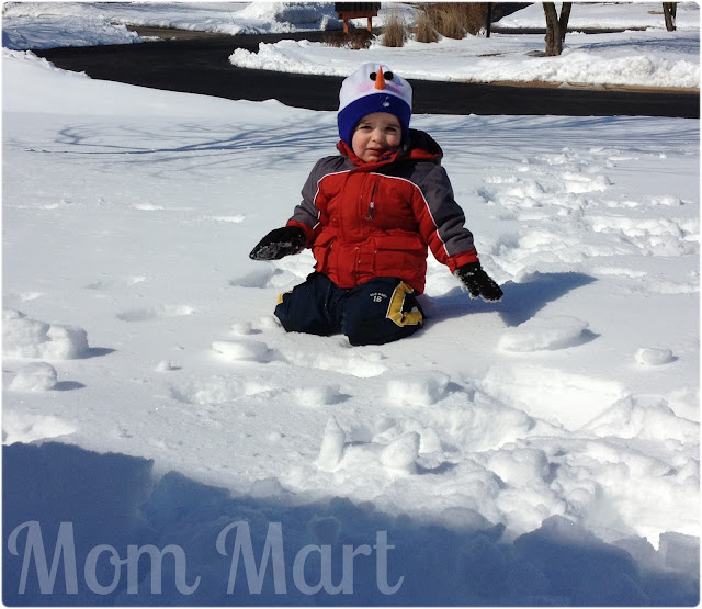 Little man cannot walk in this deep snow!