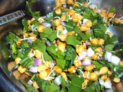 chickpea sprouts in a green salad........conditioning children to eat healthy..