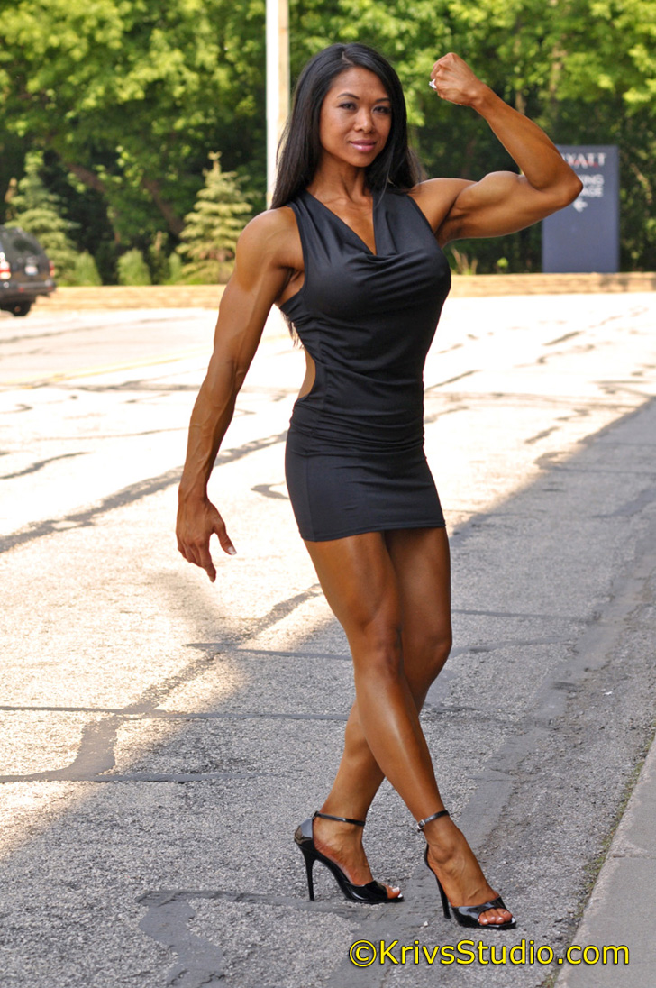 Janet Rosa Flexing Her Bicep In A Dress