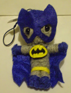 Front of vending machine Batman string doll
