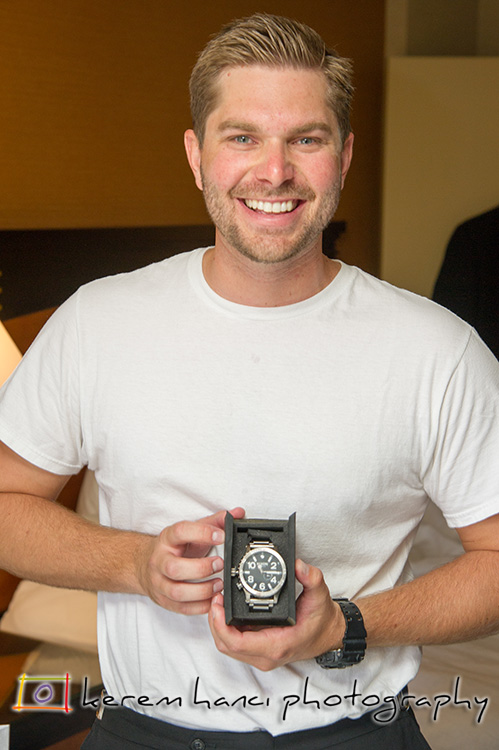 The groom received a Nixon Watch as a wedding gift from the bride