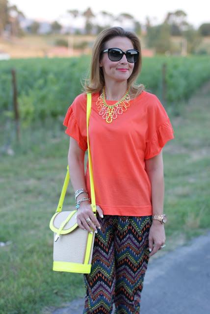 orange t-shirt, swaychic ehtnic printed pants, neon bucket bag, fashion and cookies