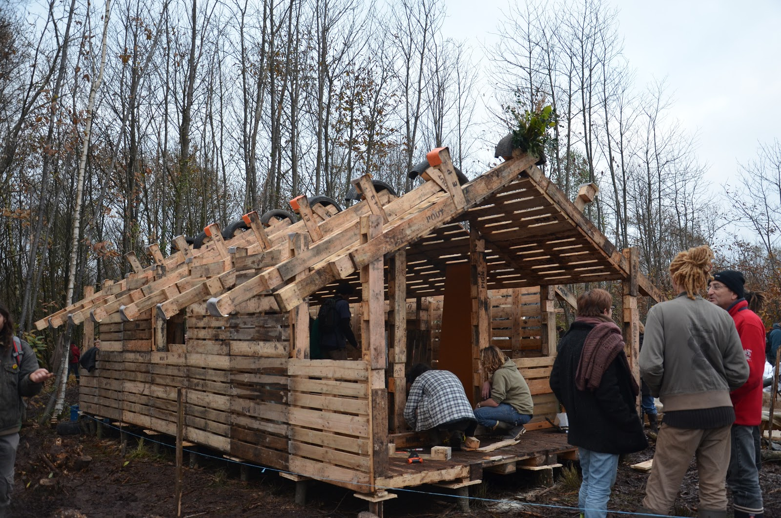 pallet buildings. french protestors build 50 pallet buildings to stop airport r