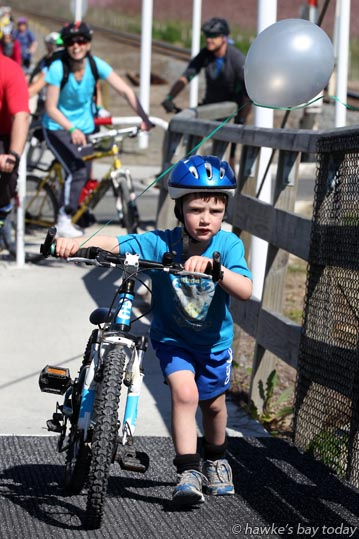 Cooper Bain, Havelock North, pushing his bike up the small incline onto the bridge near Ruahapia Rd, Ruahapia, Hastings, in the 2015 Blossom Ride from the Hawkes Bay A & P Showgrounds, Hastings, to Clive and return. photograph