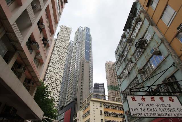 High rise condominiums and old buildings can be seen within the same street in Hong Kong