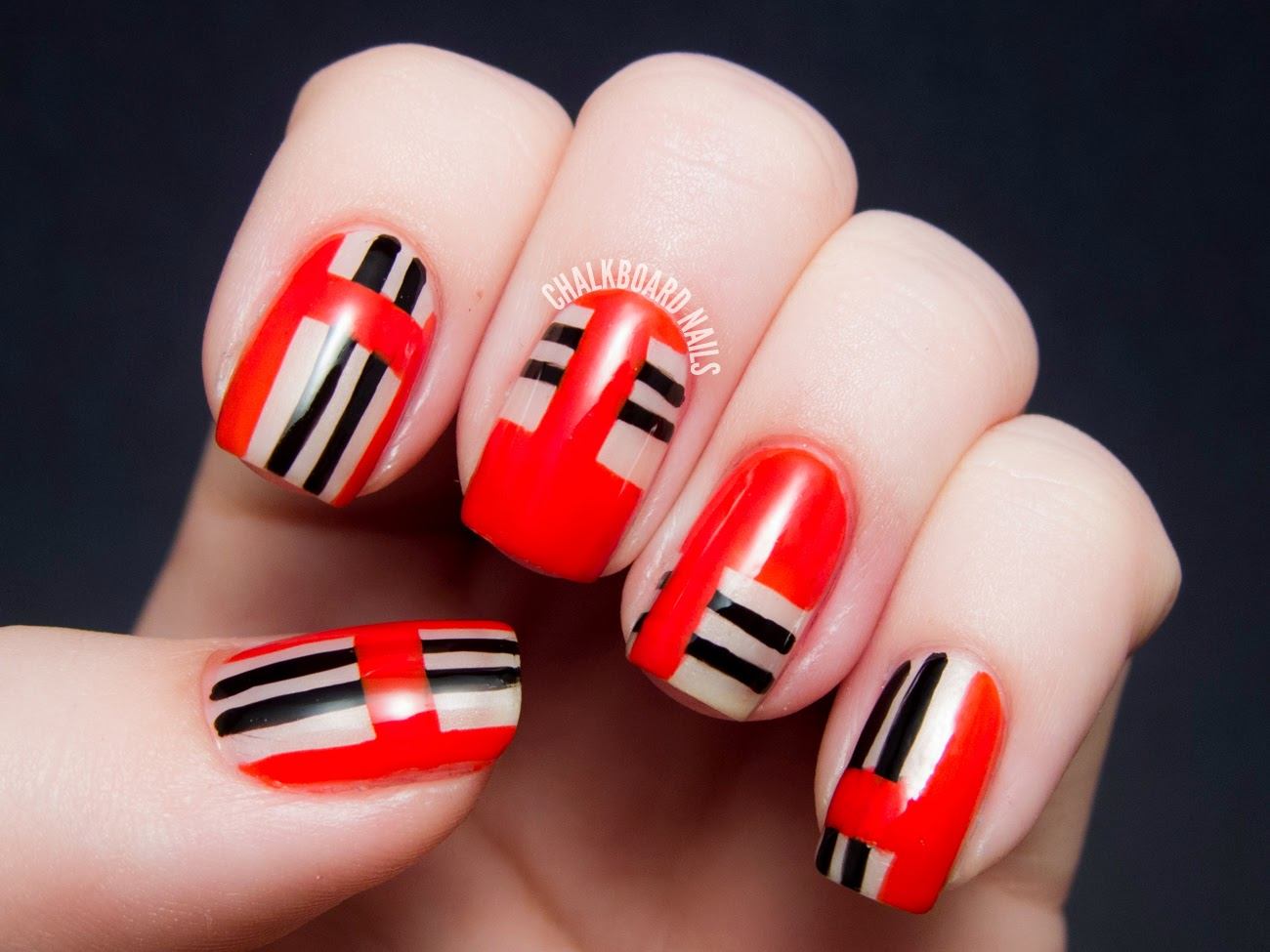 General eye catching red nail art design ideas with black and white