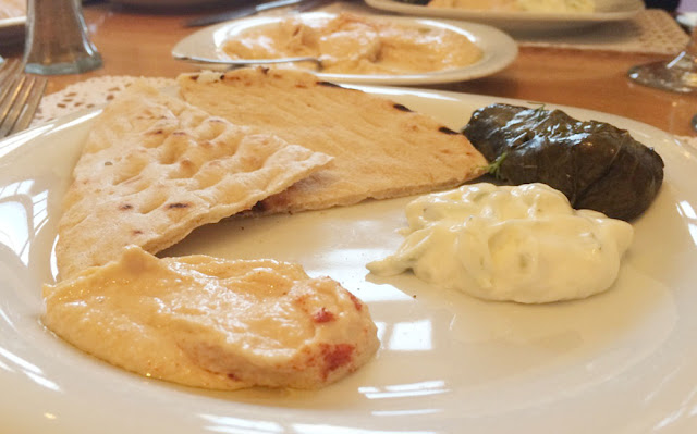 lancing restaurant pitta bread with dips and vine leaf