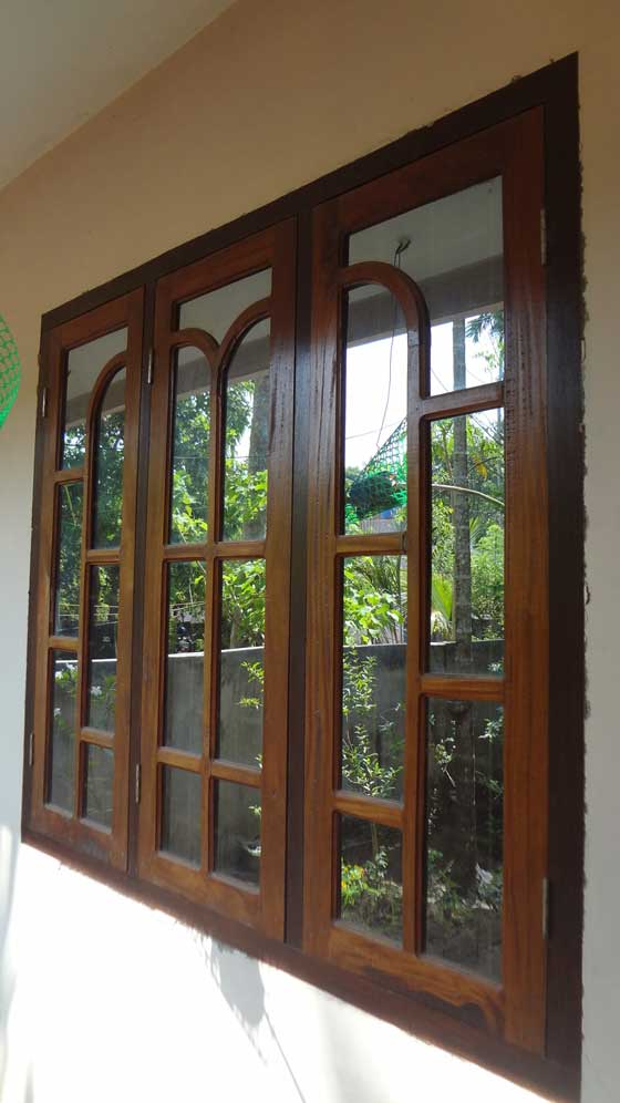 Latest kerala model wooden window door designs wood for Window glass design in kerala