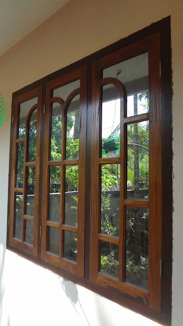 Latest kerala model wooden window door designs wood for Door models for house