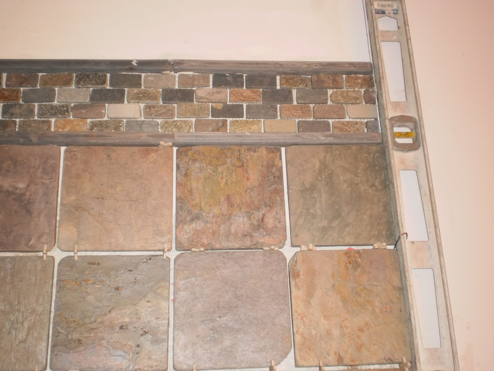 Installing natural slate tile heres how to do it ask tile wall slate ungrouted showing variation in size of tile dailygadgetfo Images