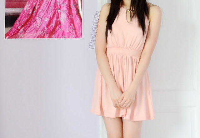 Review of the cute pink halter dress with chain necklace detailing and neckline cutouts from WalkTrendy.