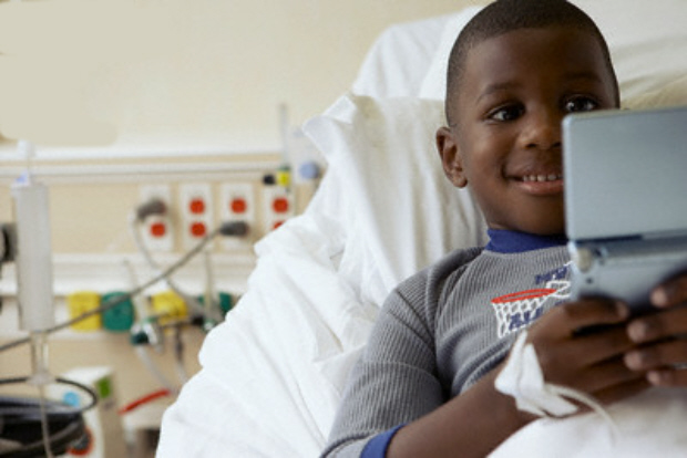 Image result for kid in hospital bed playing a game