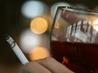 man smoking and drinking wine
