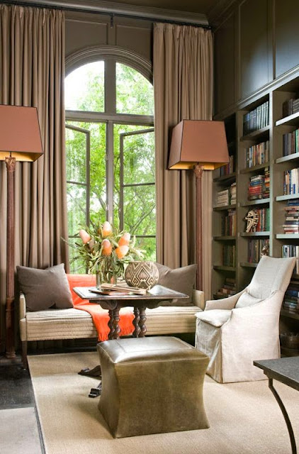 beautiful brown and cream living room den with orange hermes blanket gray painted built in bookcases